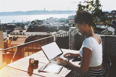 Student abroad outside laptop
